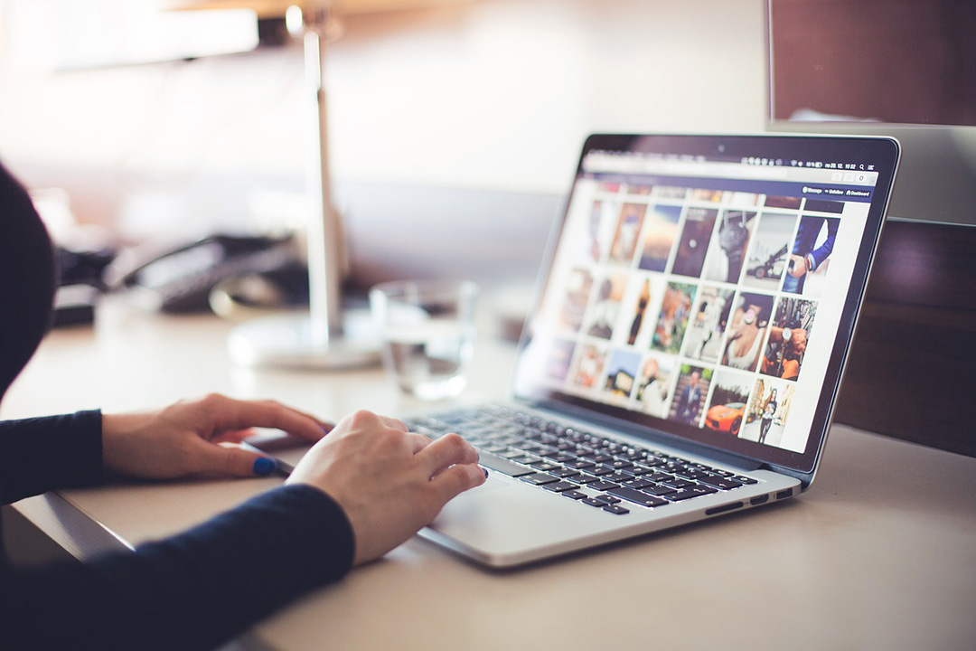 Woman on laptop looking at Pinterest