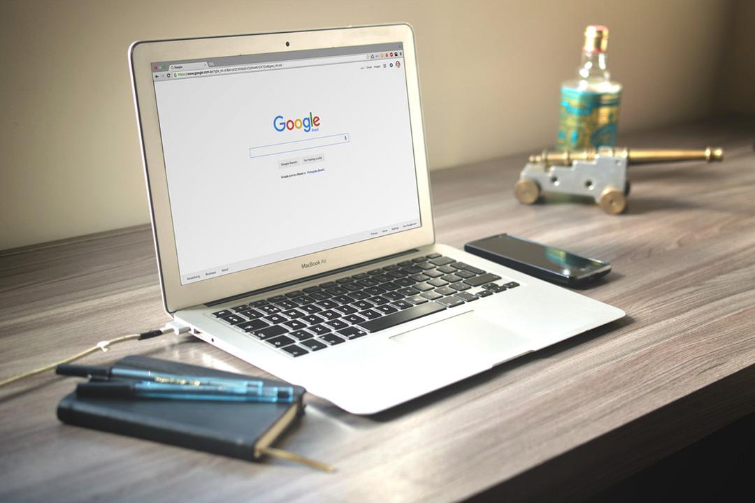 Laptop open with Google SEO tactics on screen