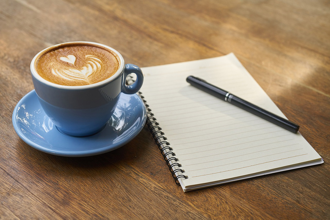 Coffee and a notepad